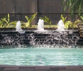 Bubblers in raised fountain cascading to pool