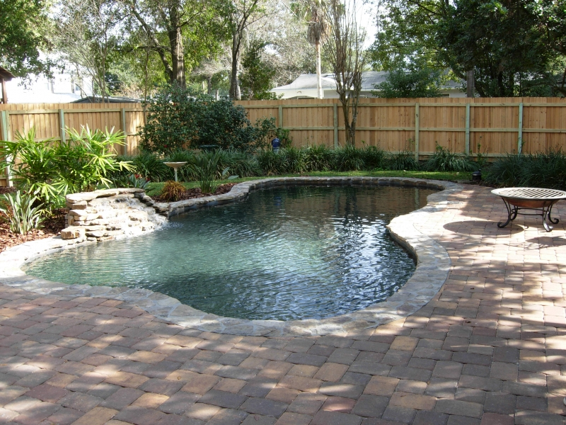 Lagoon Style Pool Designs backyard resort with lagoon style pool waterslide rock waterfall boulder accents and Freeform_lagoon_style_with_natural_stone_waterfall_stone_coping_paver_deck_and_black_pebble_interior