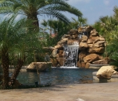 6_foot_natural_waterfall_grotto_with_boulder_stone_and_dark_pebble_interior