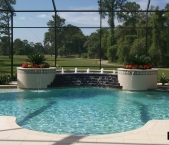 Custom_design_pool_raised_planters_raised_fountain_with_bubblers_water_cascade_to_pool