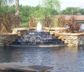 Custom_fountain_with_natural_dry_stacked_stone_and_granite_cascade