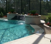 Custom_pool_with_waterfeatures_sun_shelf_dry_rescessed_bar_granite_bar_top_and_bar_stools