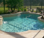 Free_form_custom_pool_and_raised_spa_with_sheer_descent_waterfeature
