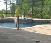 Freeform_pool_raised_deck_and_spa_with_bubbler_fountain