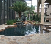 Freeform_pool_spa_water_foutain_rock_stream_kids_statue_flagstone_deck_paver_coping_and_dark_interior