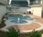 Freeform_pool_with_raised_spa_and_sundeck_acrylic_texture_cantilever_and_paver_deck
