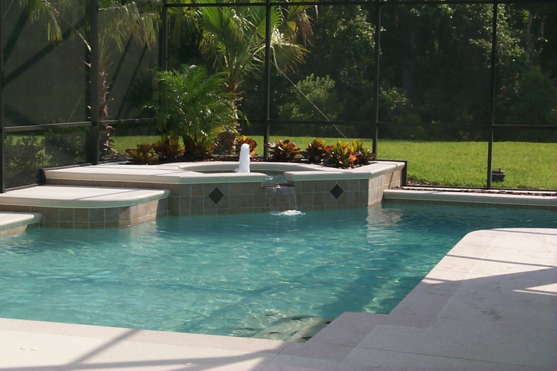 Beautiful Classic_design_with_raised_spa_custom_accent_tiles_and_concrete_acrylic_decking