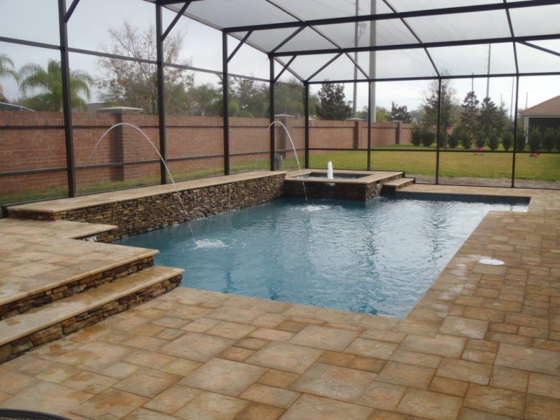 Classic_pool_raised_spa_raised_sun_deck_area_dry_stacked_stone_with_wet_wall_led_deck_jets_and_Artistic_pavers