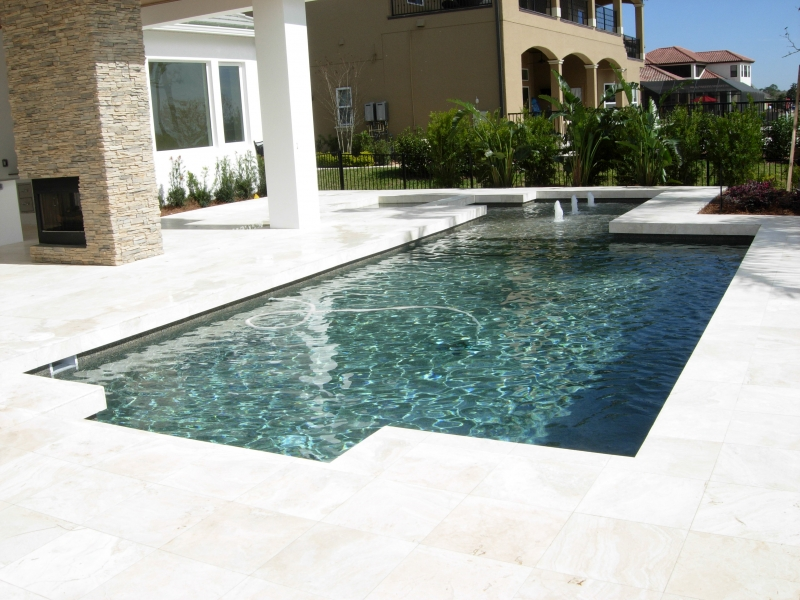 modern pool designs. Contemporary_classic_pool_design_spa_sunshelf_with_bubblers_travertine_deck_travertine_coping_and_tahoe_pebble_interior Modern Pool Designs E