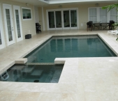 Contemporary__classic_pool._spa_with_jet_paks_glass_tile_travertine_coping_travertine_deck_and_pebble_interior