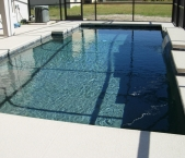 Contemporary_straight_line_pool_raised_tile_sheer_descent_waterfeature_sun_shelf_and_pebble_finish