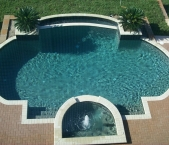 Geometric_negative_edge_pool_with_spa_infloor_cleaning_system_and_raised_planters