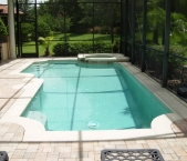 Geometric_pool_with_raised_spa_concrete_cantilever_edge_and_paver_decking