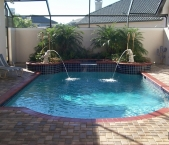 Roman_style_pool_raised_spa_dolphin_waterfeatures_brick_coping_and_paver_deck